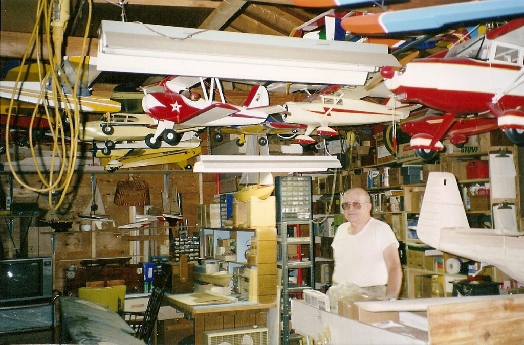Paul Lachat of Winsted, Conn., stands among his massive collection of model planes and other items that will go on auction on Dec. 6, 2009. There are more than 600 completed planes (some made of pine and dating back to the World War II era) and about 500 more kits that he bought but never assembled.