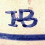 This mark was used on French Quimperware pottery made by the De la Hubaudière factory from 1883 to 1895.
