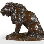 A bronze lion by Antoine Louis Barye. While it is an original by Barye, it was cast after his death by the famous foundry of Ferdinand Barbedienne. Barbedienne purchased 125 casting models from the late Barye