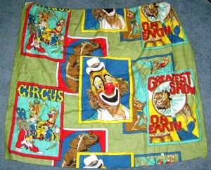 "This cloth material was sold by the yard but the manufacturer failed to get a licensing agreement with The Greatest Show On Earth. It was soon pulled and the design was altered to remove the words ""The Greatest Show On Earth"" and the famous Ringling clown image of Lou Jacobs. One yard of the original unlicensed material sold on eBay in 2008 for $10."