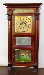 """A 39-inch 8-day repeating brass clock labeled """"C & N Jerome"""" with scored dial."""