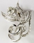 This stunning circa 1955 14kt white gold diamond brooch in a floral spray design realized $3,910.
