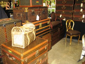 Marco Astrologo's booth at the West Palm Beach Antiques Festival features dozens of vintage of Louis Vuitton luggage and steamer trunks.