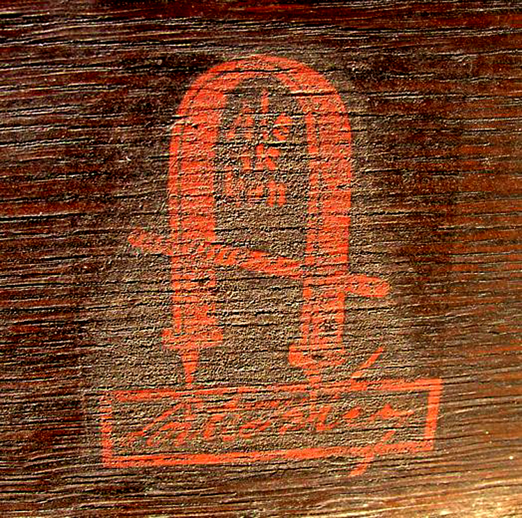 """There is no mistaking Gustav Stickley's unique red decal with the joiner's compass and his trademark quote """"Als ik Kan"""" – All I Can Do."""