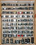 Vintage cameras in a display case.