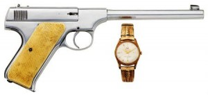 John Dillinger's nickel-plated Colt Pre-Woodsman .22 caliber automatic pistol, #5436, manufactured 1917, and a wristwatch.  Items associated with John Dillinger that Heritage Auction put up for sale on Dec. 12, 2009:   1. Dollar Bill – $14,340 (sold) 2. Wood Gun – $19,120 (sold) 3. Waltham Watch – $4,481 (sold) 4. Hamilton Watch – $41,825 (available unsold) 5. Letter – $41,825 (available unsold)  6. Monogrammed handkerchief – $5,377 (available unsold)  7. Colt pistol and wrist watch – $41,825 (available unsold)  8. Suitcase – $3,585 (sold)  9. Sporting guns – $8,962 (sold) 10. Hunting suit – $29,875 (available unsold) 11. Family documents – $3,346 (sold)