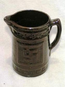 The swastika as used on this pitcher is meant as a good luck symbol and has nothing to do with Nazi Germany.