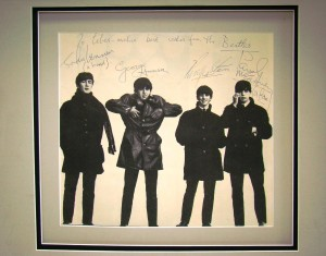 An image of the Beatles and personally inscribed by all four to the late pianist Liberace sold for $15,800.