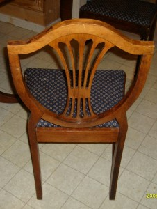 This 1940s Colonial Revival reproduction of a mahogany Hepplewhite chair is made entirely of gum.