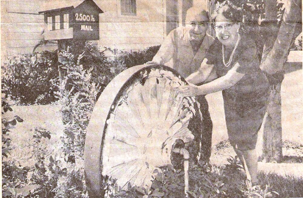 "This photo appeared in the ""Evening Independent,"" a St. Petersburg newspaper. It shows Charlotte and Bill Maxwell in their yard with one of the circus wheels."