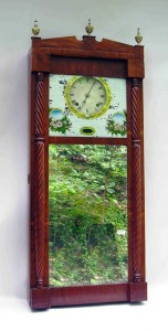 A reverse painted and mirror and wood cased wall clock by Joseph Ives was the top seller of a clock and horology auction hosted by Gordon S. Converse & Co. This clock sold for $9,200.