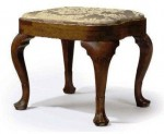 A Queen Anne carved walnut compass-seat stool.