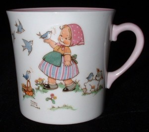 "A piece of Shelley's Nursery Ware line, featuring a little girl with birds and the verse ""Little Blue Bird, How He Sings—So Happy On My Plates And Things"""