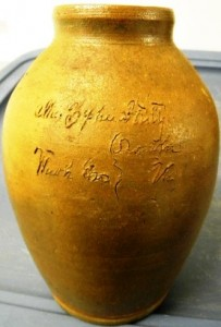 A Washington County (Va.) incised jar, 8 inches tall, made around the 1820s, inscribed.
