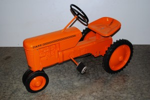 A gorgeous Case tractor, red, in mint condition will go under the gavel.