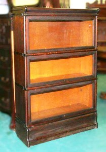 This is the typical oak Mission style Globe-Wernicke bookcase from the 1910s.