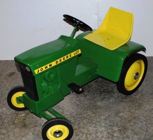 Many John Deere collectible toys, like this pedal tractor in excellent condition, will be sold at a monstrous two-day auction on Feb. 20-21, 2010.