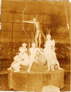 The Living Statues was a popular act during the 1920s and 1930s. Charlotte Shive is the Golden Indian in this tableau. This photo was taken by Harry A. Atwell and is valued at $75 to $100.