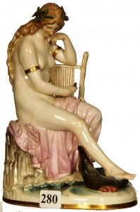 This 7-inch marked Meissen crossed sword figurine of a siren with harp and serpent went for $2,000.