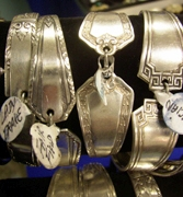 Silver bracelets with magnetic catches made from flatware.