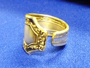 A man's ring made from apiece of sterling flatware.