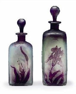 These wheel-carved glass bottles with stoppers, circa 1910 should sell for an estimate $1,800 to $2,500.