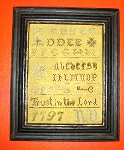 "This decorative sampler is brand new, even though it looks old and has a date of ""1797."""