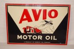 "This Avio Motor Oil (""a Product of Midwest Oil Company"") single-sided embossed tin sign sold for $5,500."