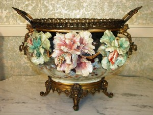 A Victorian Italian center bowl with hand-painted and embossed flowers with bronze mounts is among the items to be sold at an absolute auction on Saturday, March 27, 2010 in Abereen, Miss.