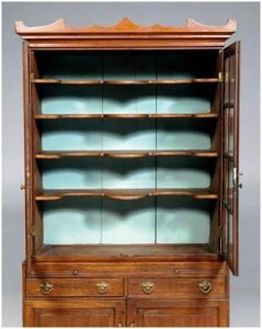 The China press has similarities to examples by well-known cabinet makers in the area, and its shelves are deeply shaped. Additionally, the piece retains most of the original glass from the late 1700s.