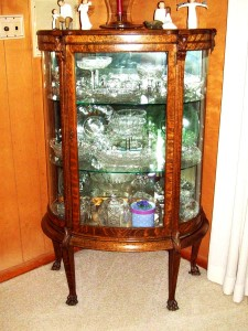 This elegant turn-of-the-century quarter-sawn oak china cabinet certainly benefited from refinishing.