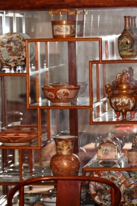 Several of Wocher's pieces are displayed in a cabinet.