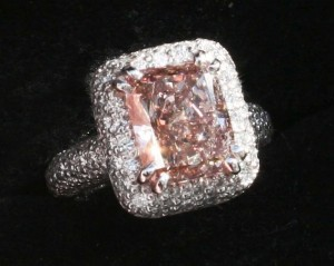 A GIA-certified, 4.02-carat brilliant cut fancy pink diamond surrounded in platinum.