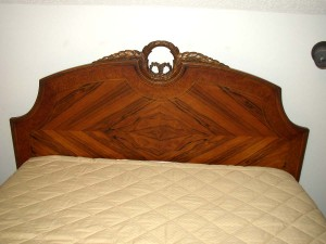 Before refinishing, the rosewood in this Depression-era headboard was invisible.