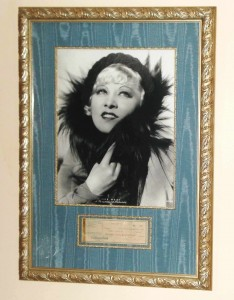 Framed silver and silk presentation of actress Mae West, with a check endorsed by her below the photo, is one of the more interesting lots in the auction, says Gordon Converse.