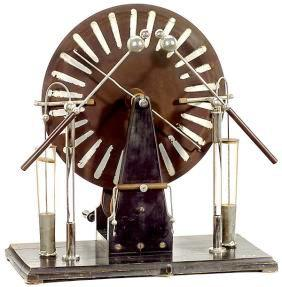 This Wimshurst Machine is an electrostatic device for generating high voltages developed between 1880 and 1883.