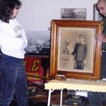 Walt Kolenda, better known as Auction Wally, appraises an antique print at the Readsboro, Vt. Historical Society