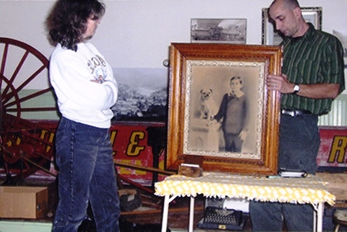 Walt Kolenda, better known as Auction Wally, appraises an antique print at the Readsboro, Vt. Historical Society's Antiques Appraisal event.