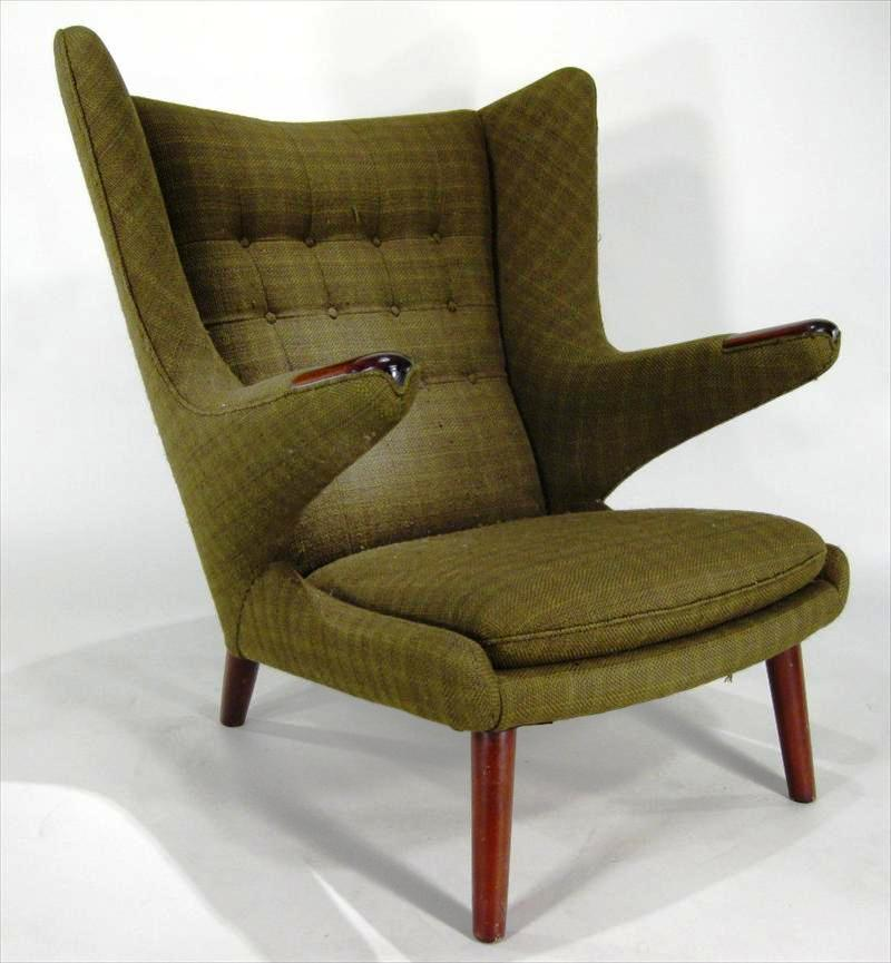 "An example of Modernist Hans Wegner's ""Papa Bear"" armchair in dark green upholstery will be among the items offered in an online auction facilitated by Litchfield County Auction that will close on April 28, 2010."