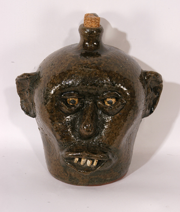 A China plate teeth face jug (circa late 1960s), attributed to Lanier Meaders, should bring between $3,000 and $5,000.