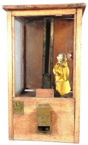 "Very early ""Yellow Kid"" wood gum vendor, in good original condition, with key ($6,000)."