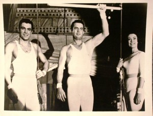 "The cutline on the back of this 8 x 10 inch publicity photo says ""Cliff Robertson (center) and members of the Krone circus family are aerialists in ""The Big Show"" on THE ABC SUNDAY NIGHT Movie. Robert Vaughn, Esther Williams and David Nelson co-star Sunday, December 24 at _______ in color on Channel _______ and the ABC Television Network."" Photos of this type are valued at $5 or less."
