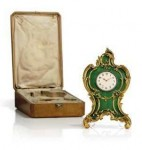 A Rococo-style silver-gilt and guilloche enameled desk clock by the Fabergé's head workmaster Michael Perchin, made circa 1890 in St Petersburg (estimate: $180,000-$200,000).