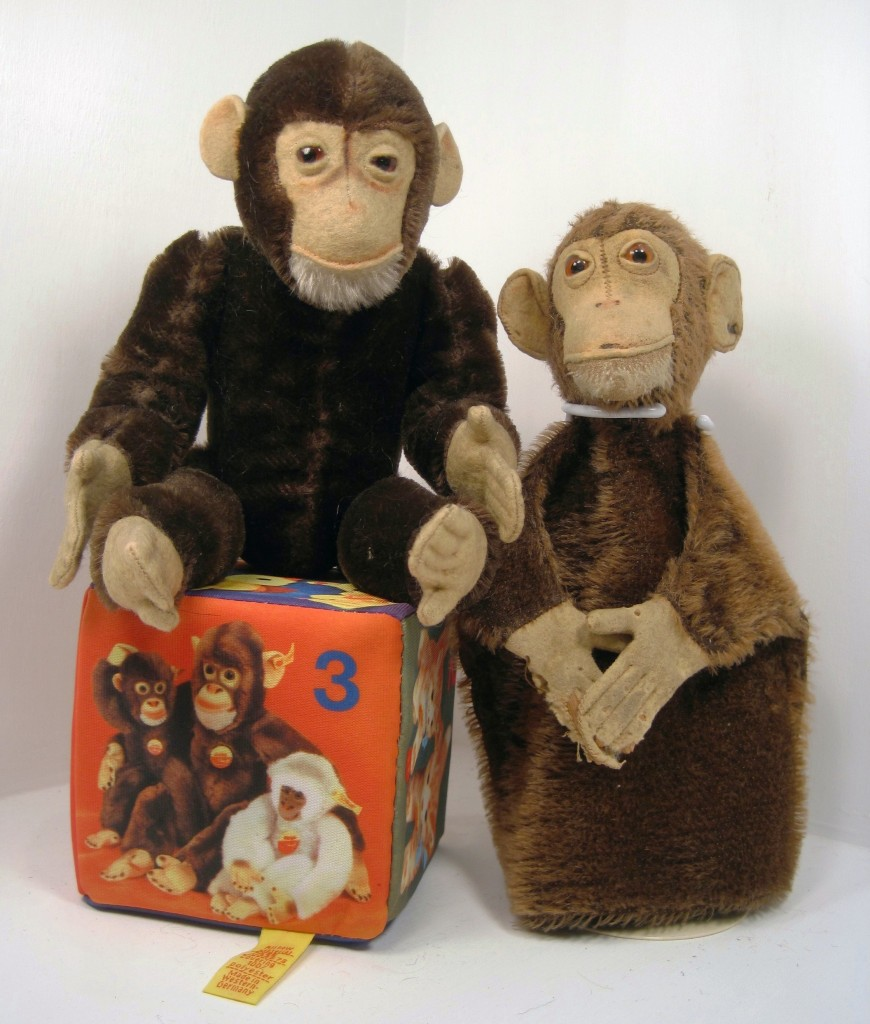 Two Steiff Jocko the Chimps from the 1910-1920 time frame; The one on the left is a dark brown fellow in absolute pristine condition (sitting on a modern-day Steiff play block) while the other is a very loved, but still proud, Jocko puppet.