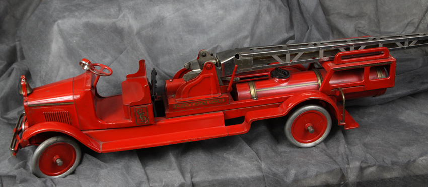 This fully functional 1936 Buddy 'L' #28 Water Tower Truck, measuring 45 inches long, is estimated to bring between $3,800 and $4,200 in a massive, two-weekend sale featuring the toy collections of a five-brother Midwestern family.