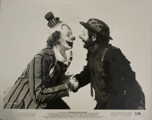 The most desirable photos from the motion picture are those licensed to theaters by National Screen Service Corp. like the one featuring Jimmy Stewart in clown makeup and world famous clown Emmett Kelly. These are valued at $10 and up.