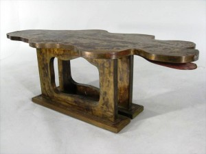 Amorphous figural sliding coffee table by Philip and Kevin Lavern, mid 20th century ($6,300).