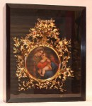 This Victorian painting on porcelain in black shadow box with ornate gold frame gaveled for $4,480.