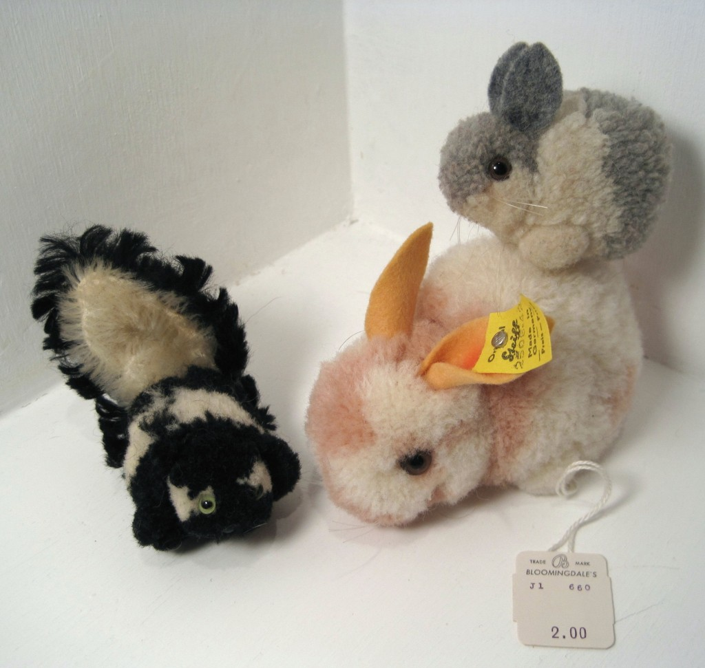 "Woll-Hase"" or woolen rabbits. Please also note the original attached price tag still on the larger bunny's foot . . . she was $2 at Bloomingdale's in 1967, which translates into about $13 today. Also pictured is the Steiff woolie and mohair skunk from 1954-1978."