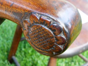 The sunflower carved into the arm of the Chippendale chair indicates a Litchfield provenance.